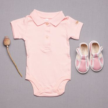 Slippers and aGOTS bodysuit – pink